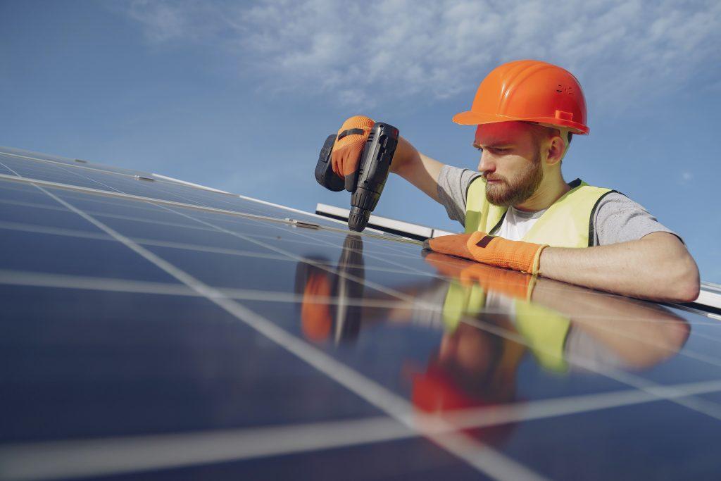 electrician installing solar-panels