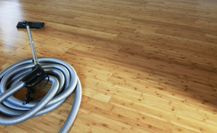 central vacuum coiled on the floor
